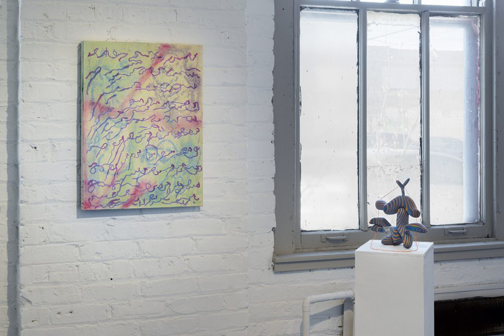 gallery installation of a group show featuring prints, photographs and paintings