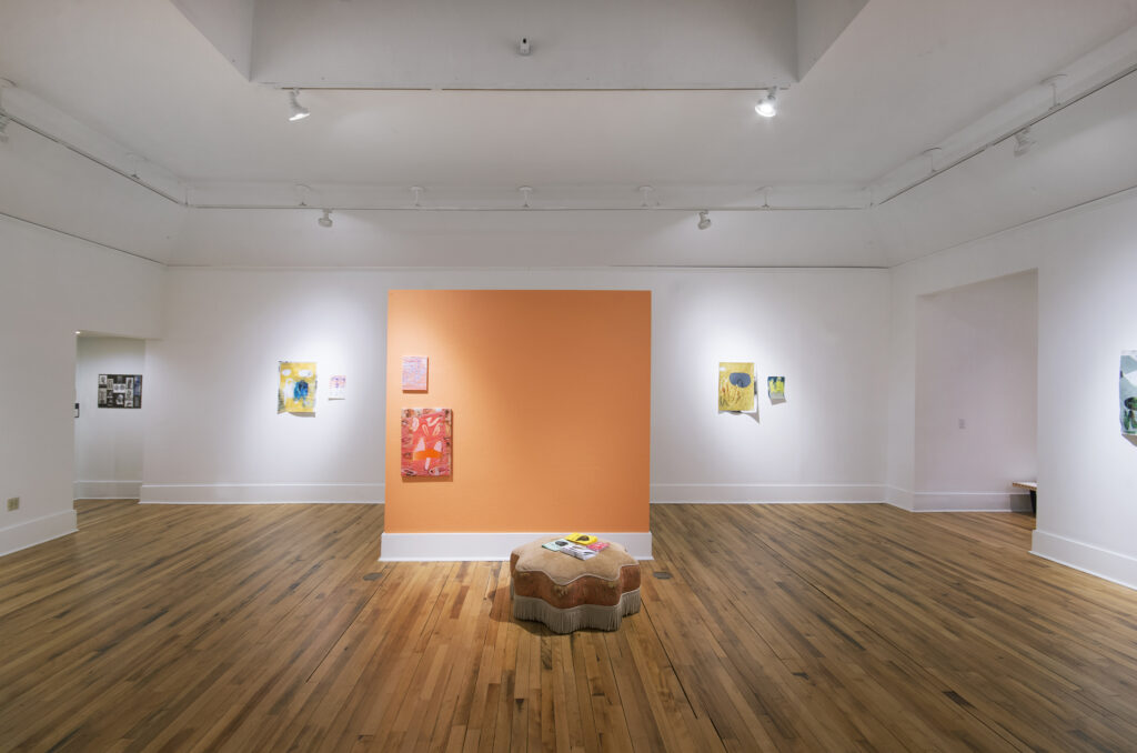 gallery exhibition of numerous colored collaged works on paper