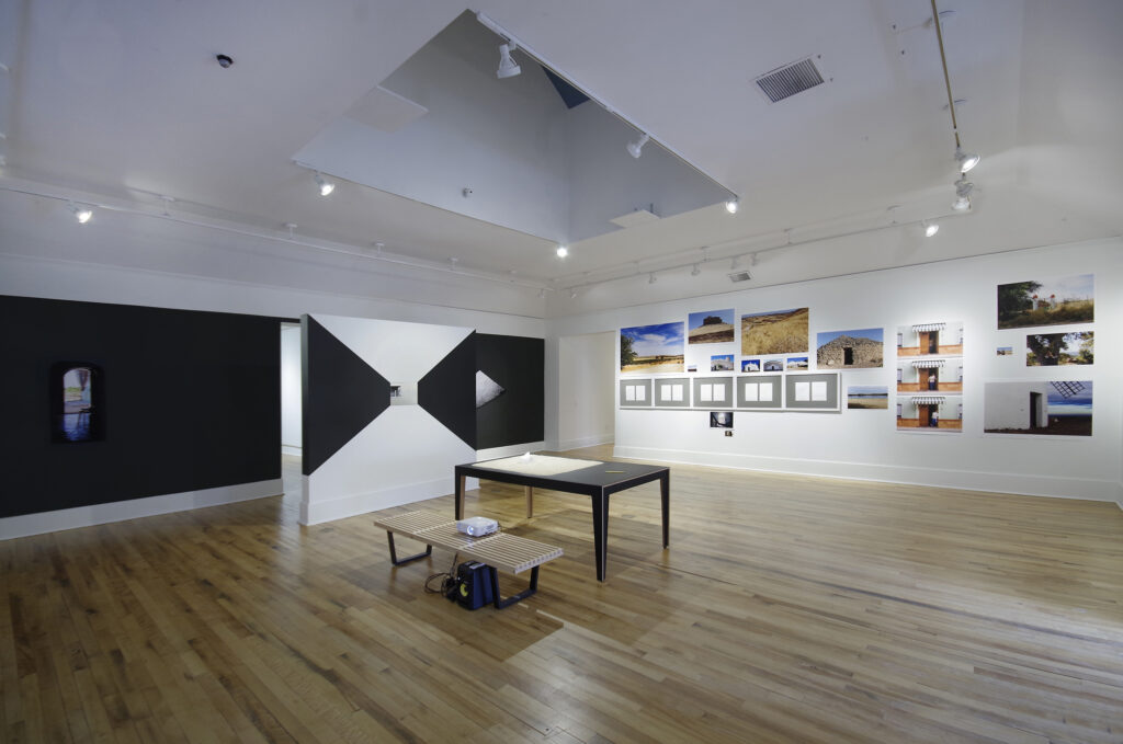 art installation comprising of photographs, mural and ephemera presented on a table