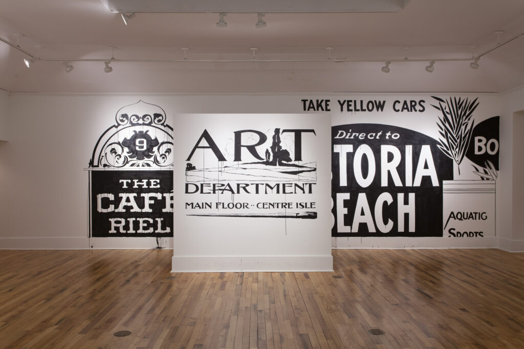 Gallery exhibition of black and white painted sign murals at Providence College Galleries