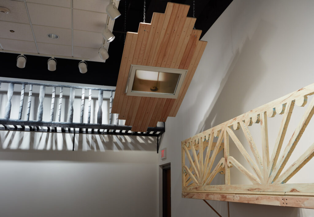 gallery installation with numerous large wall-mounted architectural sculptures