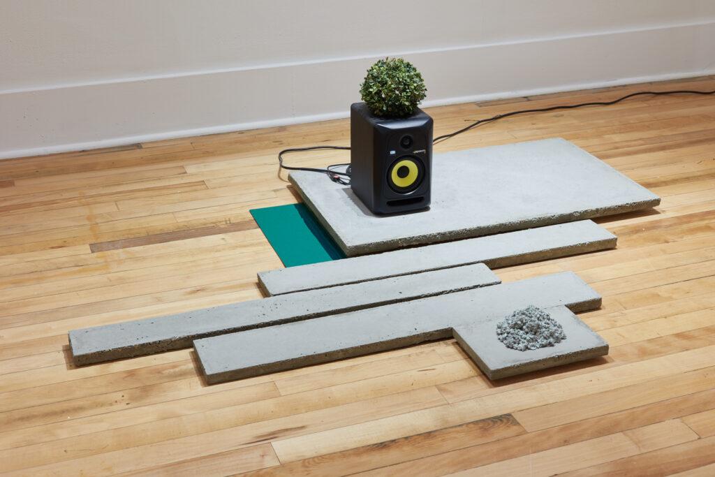 minimalist art installation of concrete and plexiglass contemporary sculpture